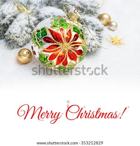 Christmas greeting card. Christmas bauble with poinsettia design, decorated branches of Christmas tree on snow. Space for your text on plain white background below the picture. - stock photo