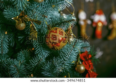 Christmas greeting card. Decorated Christmas tree on blurred, sparkling and fairy background. Beautiful color christmas decorations hanging on christmas tree with shiny glare - stock photo