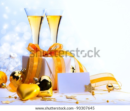 Christmas greeting card ( glasses of champagne vine and Christmas gifts, New Year party )