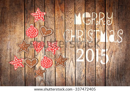 Christmas greeting card 2015, rustic ornaments on wood planks background creating the shape of a Christmas tree