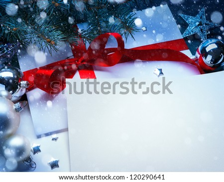 Christmas greeting card with a branch of tree and Christmas decorations - stock photo