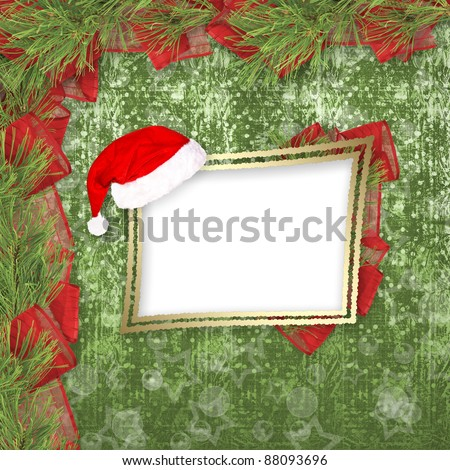 Christmas greeting card with branches of spruce and ribbons
