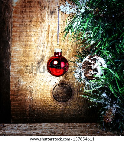 Christmas greeting card with Christmas Decorations on grunge wooden background with copy space.  - stock photo