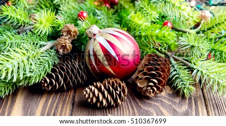 Christmas greeting card with cone red ball fir branches