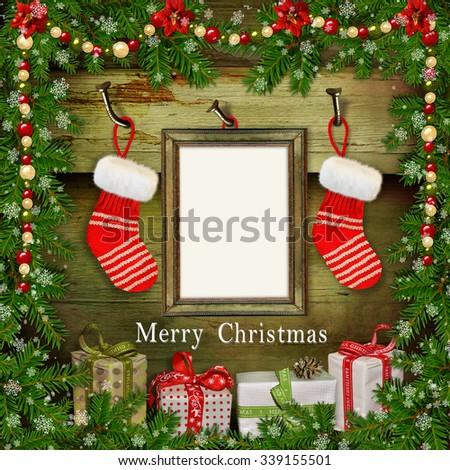 Christmas greeting card with frame, Christmas socks, gifts - stock photo