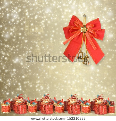 Christmas greeting card with presents on the gold abstract background