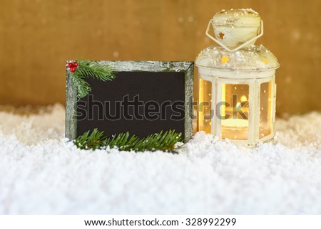Christmas greeting card with snow, lantern and signboard - stock photo