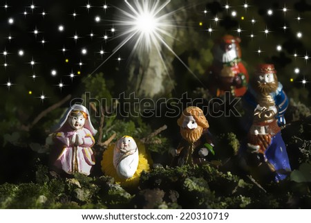 Christmas greeting cards, figurines of the Holy Family and three wise men - stock photo