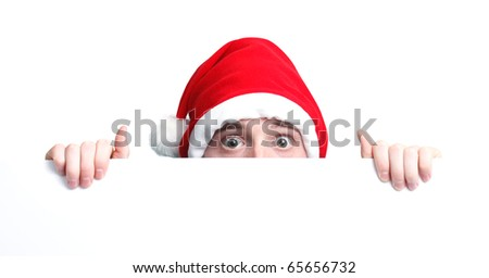 Christmas Guy with santa hat and sign - stock photo