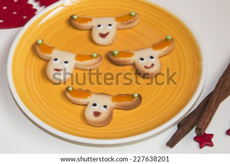 Christmas handmade cookies reindeer on white background - stock photo