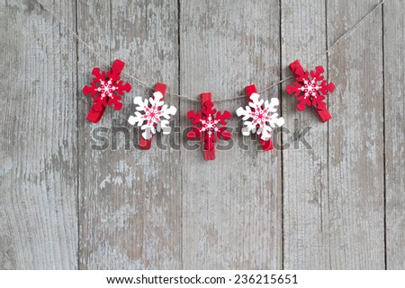 Christmas hanging clothespins decoration over a wooden table. - stock photo