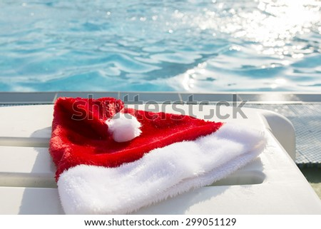 Christmas hat by the swimmingpool on a sunny day