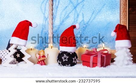 Christmas hats, candles, gift, angel - stock photo