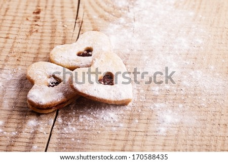 Christmas heart cakes on wooden background