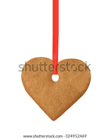 christmas heart cookie on red ribbon isolated on white background - stock photo