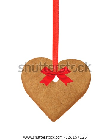 christmas heart cookie on red ribbon with bow isolated on white