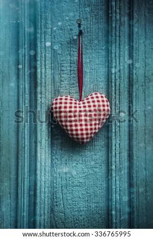 Christmas heart ornament hanging on door - stock photo