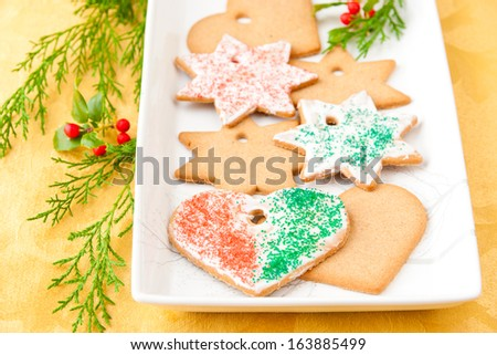 Christmas heart shaped and stars cookies  on a plate. selective focus, shallow dof - stock photo