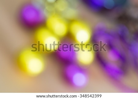 Christmas holiday abstract background with defocused glittering purple and yellow decorations - stock photo