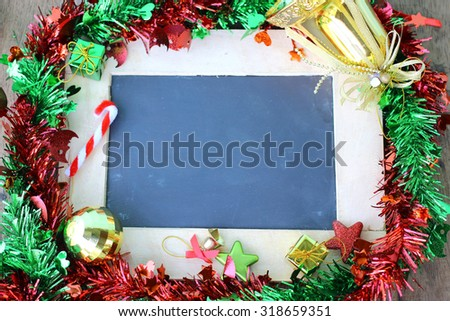 Christmas holiday background and Christmas decorations with blank chalkboard frame for copy space.   - stock photo