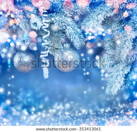Christmas Holiday Background, Hanging baubles on Christmas tree, New Year backdrop with snow. Decoration. Abstract Blurred Blue Bokeh, Blinking Garland. Christmas Tree decorated, Lights Twinkling - stock photo