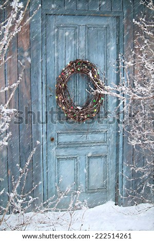 Christmas holiday background with barn door and wreath/ digital painting - stock photo
