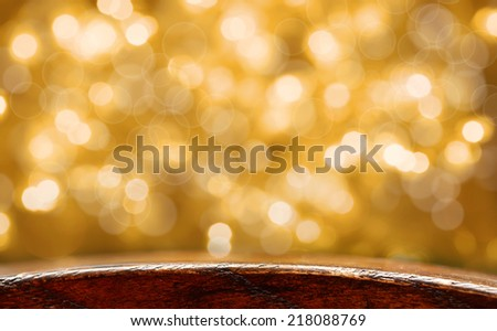 Christmas holiday background with empty wooden deck table over festive yellow bokeh - stock photo