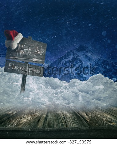Christmas holiday background with sign post and Santa hat - stock photo