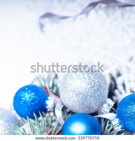 Christmas holiday decoration. Blue ornament bauble with branch of fir, pine and snowflake on white background. Festive merry xmas, new year celebration. Golden decorative ball.