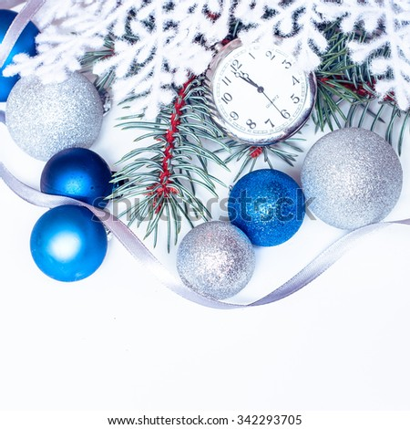 Christmas holiday decoration. Blue, white ornament bauble with brunch of fir or pine, ribbon and old retro clock background. Festive merry xmas, new year celebration. Golden shiny  ball.  - stock photo