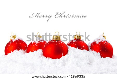 Christmas holiday decoration with white snow and festive red balls