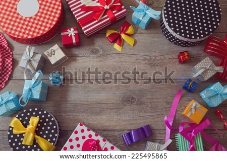 Christmas holiday gift shopping background. View from above with copy space - stock photo