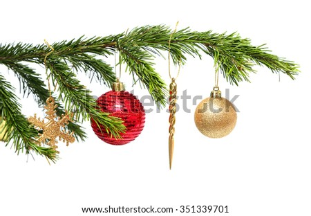christmas holiday toys on fir tree twig over white background - stock photo