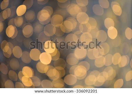 christmas, holidays and background concept - blurred golden lights bokeh - stock photo