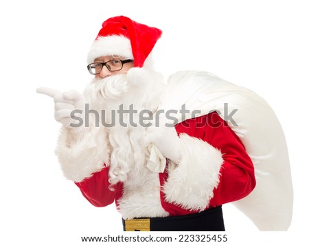 christmas, holidays and people concept - man in costume of santa claus with bag pointing finger