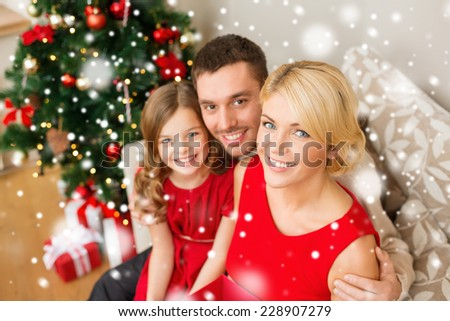 christmas, holidays, happiness and people concept - smiling family with gift box at home - stock photo