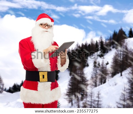 christmas, holidays, technology and people concept - man in costume of santa claus with tablet pc computer over snowy mountains background - stock photo