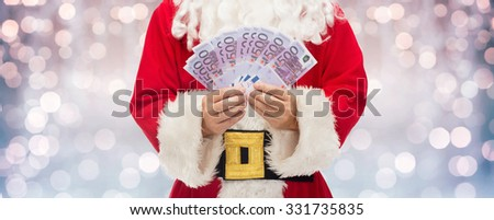 christmas, holidays, winning, currency and people concept - close up of santa claus hands holding euro money over lights background - stock photo