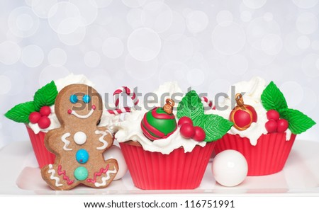 Christmas homemade cupcakes with gingerbread man - stock photo