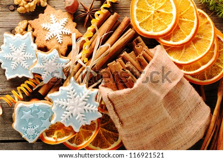 Christmas homemade gingerbread cookie and spices over wooden table - stock photo