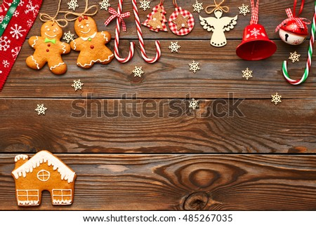 Christmas homemade gingerbread cookies and handmade decoration on wooden background