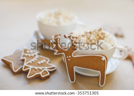 Christmas homemade gingerbread cookies, hot chocolate with marshmallow on the table - stock photo