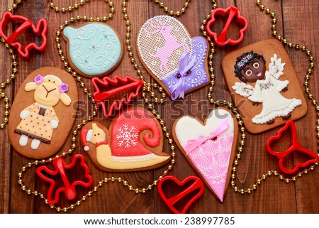 Christmas homemade gingerbread cookies on wooden background - stock photo