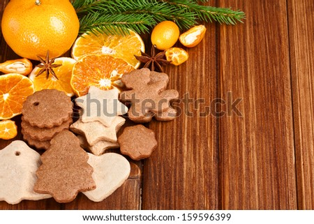 Christmas homemade gingerbread cookies,spice and decoration over  wooden board