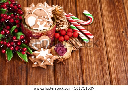 Christmas homemade gingerbread cookies,spice and decoration over  wooden board - stock photo