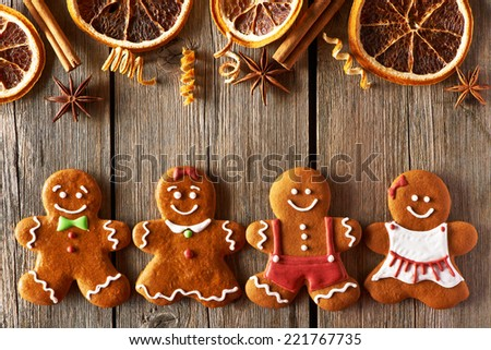 Christmas homemade gingerbread couple cookies on wooden table - stock photo
