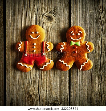 Christmas homemade gingerbread man on wooden table - stock photo