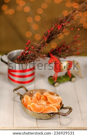 Christmas horse toy and mandarin slices - stock photo