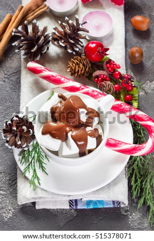 Christmas hot chocolate with marshmallows in a cup and holiday d