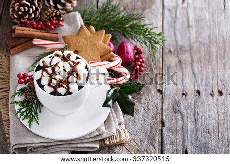 Christmas hot chocolate with ornaments and candy cane - stock photo